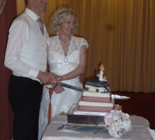 Dean & Joanne use sabre to cut wedding cake Portrush 8th September