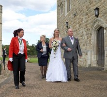 Your_lady_toastmaster_escorting_bride_and_father_to_the_wedding_ceremony_leeds_castle